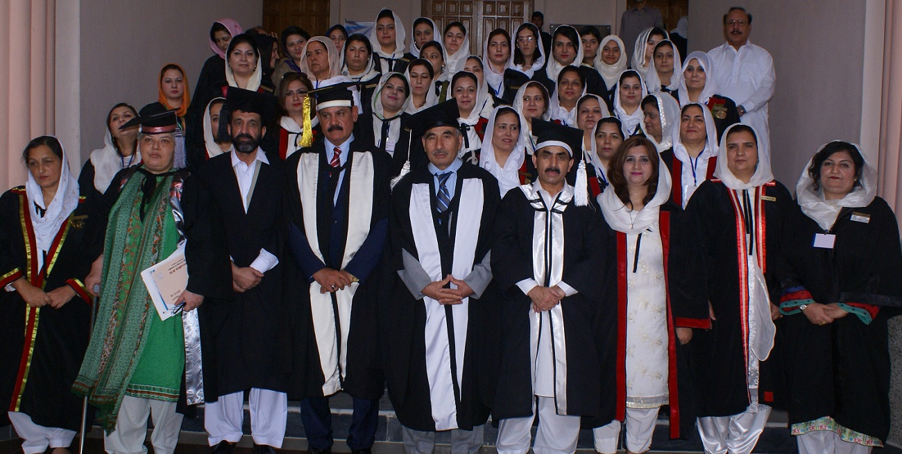 Minister for Higher Education Mr. Mushtaq Ahmed Ghani and VC UoP Prof. Dr. Muhammad Rasul  Jan  in group photo with faculty members of College of Home Economics on the occasion of 17th Convocation