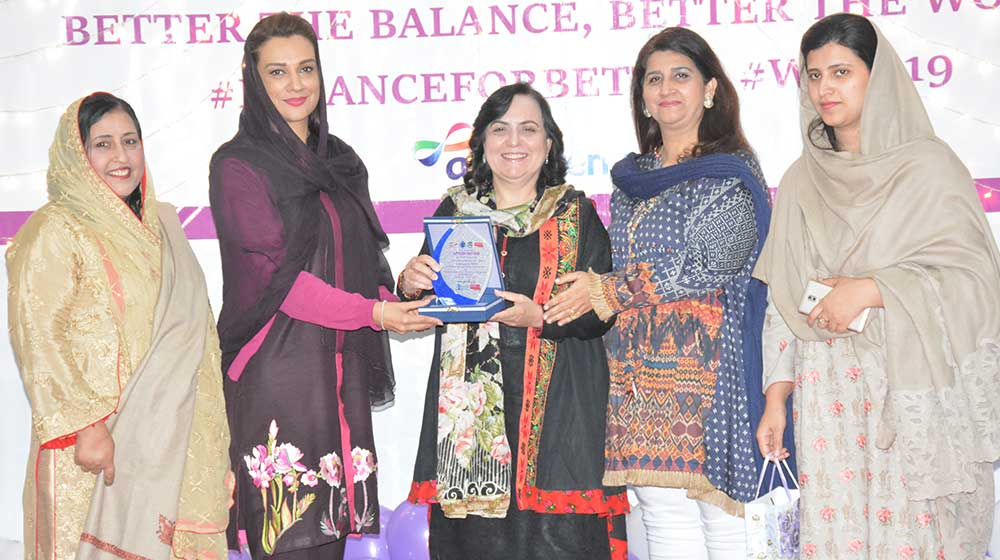 Prof.Noor Jahan chief guest on International Women's day event at TCC hall is handing over shield to guest of honor Ms.Ayesha Bano, MPA, before her departure from the function on 08th March,2019.