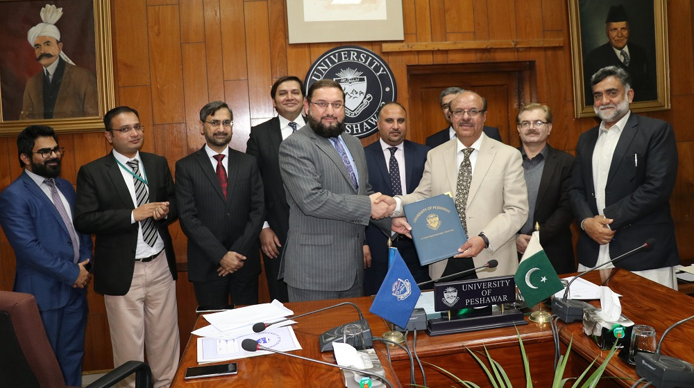 Vice Chancellor University of Peshawar is shaking and sharing MoU copies with the Habib Bank Limited regional chief Mr. Shehzad Haider for  bolstering  financial services to employees of the University of Peshawar on 30th January, 2020.