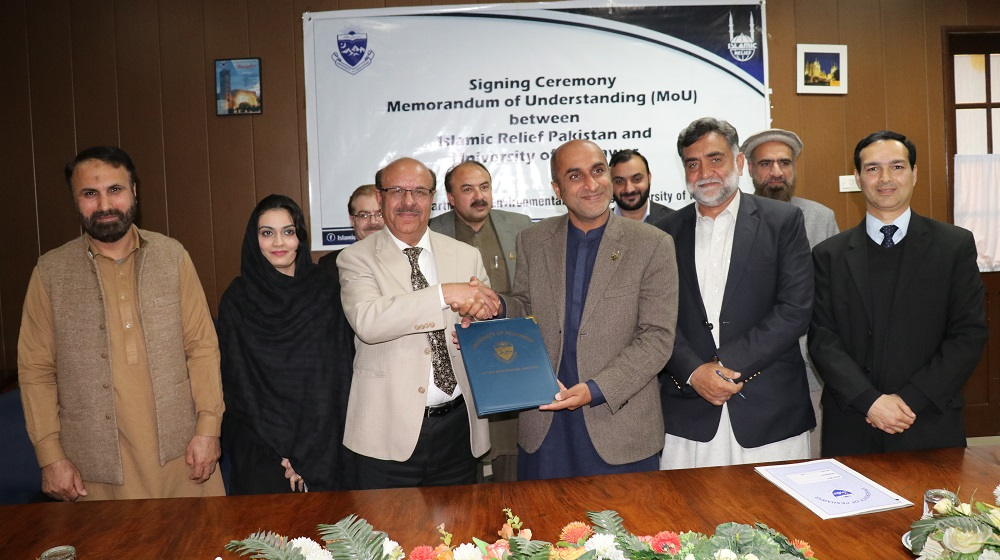 Vice Chancellor University of Peshawar is shaking hands  and sharing MoU copies with acting country director, Islamic Relief Pakistan  Raza Narejo for promoting  mutual environmental projects at Committee room I   University of Peshawar on 30th January, 2020.