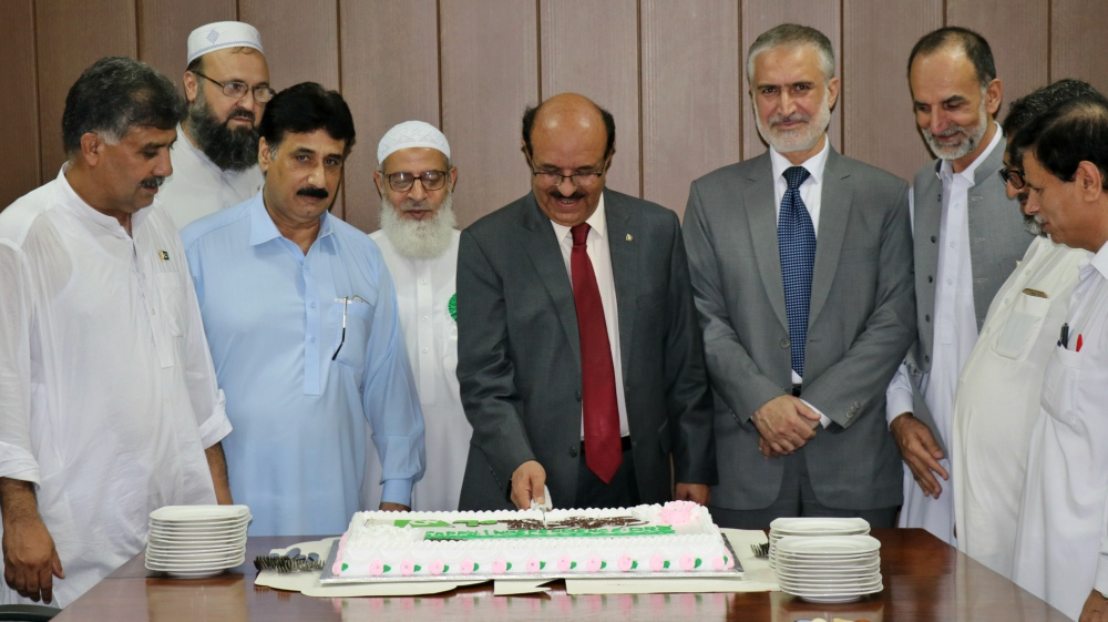 Vice Chancellor UoP Prof. Dr. Muhammad Asif Khan cutting independence day cake at the University of Peshawar