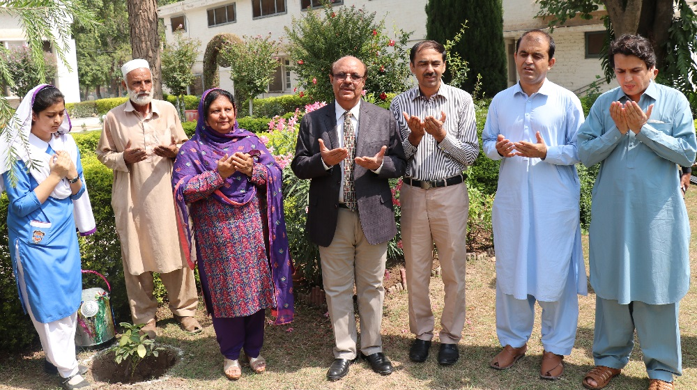 The Vice Chancellor University of Peshawar along President PUTA are offering good will pray on the occasion of 'Plant a Tree for Pakistan' campaign  at the University Model School on Tuesday.