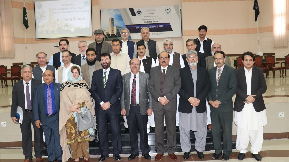 The Vice Chancellors of  public sector universities of Khyber Pakhtunkhwa are posing for a group photo with Chairman Higher Education Commission Dr. Tariq Buneri at the convocation hall, University of Peshawar