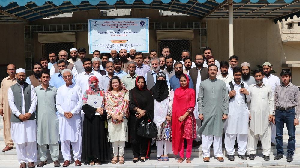 The pro-vice chancellor, University of Peshawar Prof. Dr. Muhammad Abid posing with a group of 40 participants at the inaugural session of two-day workshop entitled as