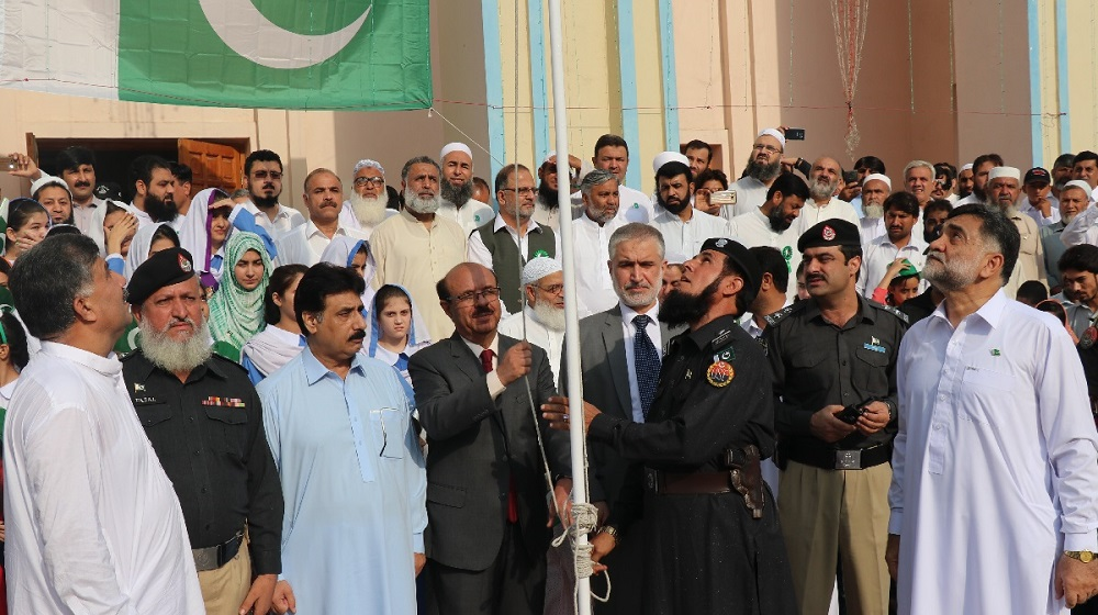 Vice Chancellor UoP Prof. Dr. Muhammad Asif Khan Hoisting National Flag on the Independence Day of Pakistan at the University of Peshawar