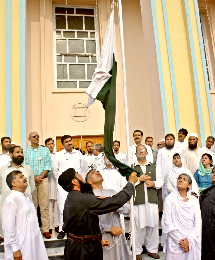 Vice Chancellor UoP Prof. Dr. Muhammad Rasul Jan hoisting national flag on the occasion of 69th independence day at UoP