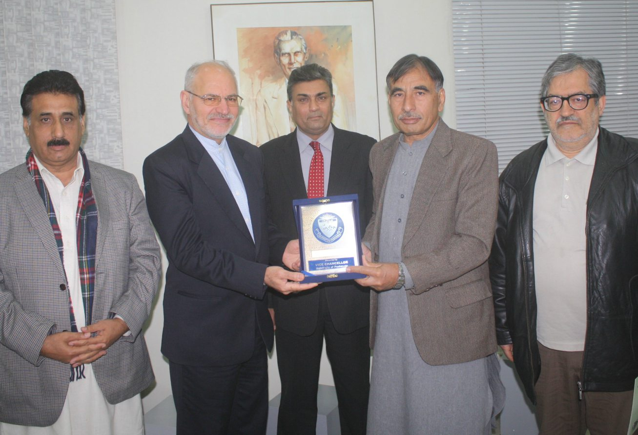 Vice Chancellor UoP Prof. Dr. Muhammad Rasul Jan presenting souvenir to Mr. Muhammad Baqir Begi Consul General of Iran during his  visit ot the University of Peshawar