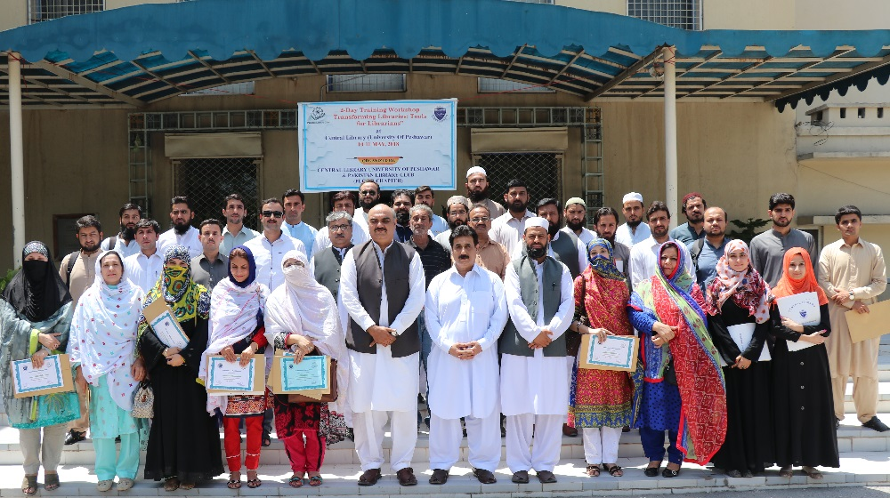 The registrar, University of Peshawar  Dr. Zahid Gul posing with a group of 40 participants at the concluding session of two-day workshop entitled as